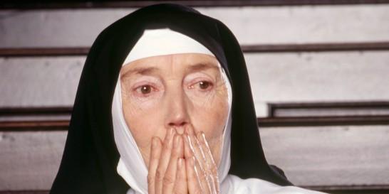 Portrait of surprised nun