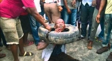 Execution-Methods-Necklacing-Victim-31